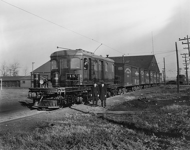 2018.008.IT.077--bruce meyer 5x7 COPY neg--ITS--new freight motor 1579 posing with four wooden boxcars at shops--Decatur IL--1924 0000