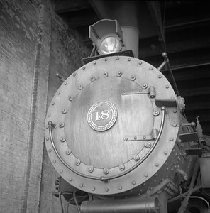2018.008.LSTT.S.03--bruce meyer 120 neg--LST&T--steam locomotive 0-8-0 18 inside roundhouse--Superior WI--1956 0902