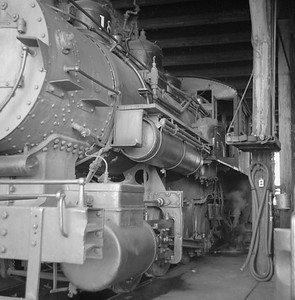 2018.008.LSTT.S.02--bruce meyer 120 neg--LST&T--steam locomotive 0-8-0 18 inside roundhouse--Superior WI--1956 0902