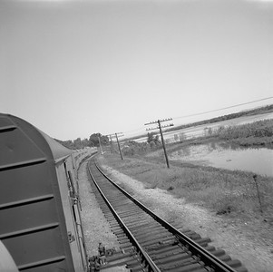2018.008.MIL.0122--bruce meyer 120 neg--CMStP&P--view from EMD diesel cab of passenger train 16--south of Red Wing MN--1961 0604