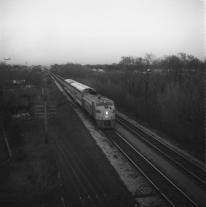 2018.008.MIL.0217--bruce meyer 120 neg--CMStP&P--EMD diesel locomotive 95-A on commuter passenger train--Bensenville IL--1971 0422