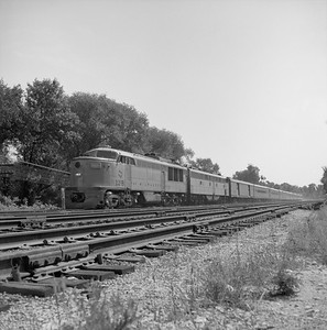 2018.008.MIL.0030--bruce meyer 120 neg--CMStP&P--FM diesel locomotive 12-B on The Challenger passenger train--Franklin Park IL--1958 0809