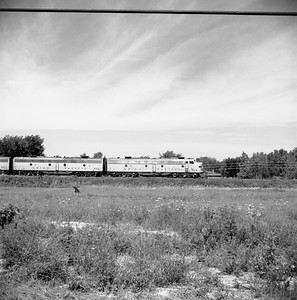 2018.008.MIL.0035--bruce meyer 120 neg--CMStP&P--EMD diesel locomotive UP 929 on City of San Francisco passenger train eastbound--east of Roselle IL--1958 0809