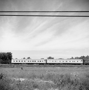 2018.008.MIL.0037--bruce meyer 120 neg--CMStP&P--City of San Francisco passenger train hind end eastbound--east of Roselle IL--1958 0809
