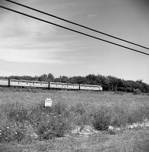 2018.008.MIL.0036--bruce meyer 120 neg--CMStP&P--EMD diesel locomotive UP 929 on City of San Francisco passenger train eastbound--east of Roselle IL--1958 0809