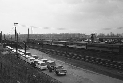 2018.008.NKP.PD.1375--bruce meyer 35mm neg--NKP--EMD diesel locomotive on eastbound passenger train at 130th and Torrence Ave--Chicago IL--1963 0400
