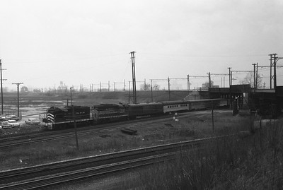 2018.008.NKP.PD.1374--bruce meyer 35mm neg--NKP--EMD diesel locomotive on eastbound passenger train at 130th and Torrence Ave--Chicago IL--1963 0400