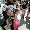 Boston Bruins FanFest came to Doyle Field on Thursday, August 22, 2019. Fans swarm the Bruins mascot Blades during the event. Posing with Blades is, from left, Jenna Wolton, 8, Kayleigh Wolton, 6, and Adisynne Wolton, 9, from Milford N.H. SENTINEL & ENTERPRISE/JOHN LOVE