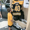 Boston Bruins FanFest came to Doyle Field on Thursday, August 22, 2019. Jacob Cox, 8, from Wilmington looks a a mockup of Bruins Goalie Tuukka Rask's locker at the FanFest. Everything in the locker was Rask's equipment he wore. Cox also plays goalie for the North Shore Shamrocks. ENTINEL & ENTERPRISE/JOHN LOVE