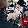 Boston Bruins FanFest came to Doyle Field on Thursday, August 22, 2019. Nolan Bean, 5, from Fitchburg tries on a helmet during the FanFest to see which size he should buy. SENTINEL & ENTERPRISE/JOHN LOVE