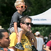Boston Bruins FanFest came to Doyle Field on Thursday, August 22, 2019. Jacob Roberts, 3, gets a better view of the events from his dad Michael Roberts' Shoulders. SENTINEL & ENTERPRISE/JOHN LOVE