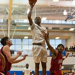 Ballard\'s Corey Douglas (4) took a one-handed attempt at a basket.