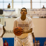 Ballard\'s Anthony Eaves (5) was awarded a trip to the free throw line.