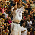 With the Ballard faithful behind him, Anthony Eaves (5) let go a three-point attempt.