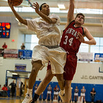 Anthony Eaves (5) took it to the hoop against Manual\'s Jake Chilton (34).