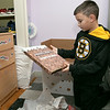 Bob's Discount Furniture partnered with the Boston Bruins and One Mission to donate and deliver new home furnishings to a local Fitchburg family. The youngest of the family Juliet Robichaud, 3, is currently battling Acute Myeloid Leukemia and Bob's wanted to commend her bravery by gifting Juliet her dream bedroom! In addition, the rest of the family got gifts for their rooms from the Bruins. Bruins Alum PJ Stock and mascot Blades were on hand to welcome Juliet home from school and surprise her with her new room on Tuesday, Jan. 7, 2019. Juliet shares a room with her sister Ellie, 7. Their brother Brayden looks over some of the stuff he got from the team. SENTINEL & ENTERPRISE/JOHN LOVE