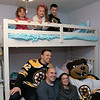 Bob's Discount Furniture partnered with the Boston Bruins and One Mission to donate and deliver new home furnishings to a local Fitchburg family. The youngest of the family Juliet Robichaud, 3, is currently battling Acute Myeloid Leukemia and Bob's wanted to commend her bravery by gifting Juliet her dream bedroom! In addition, the rest of the family got gifts for their rooms from the Bruins. Bruins Alum PJ Stock and mascot Blades were on hand to welcome Juliet home from school and surprise her with her new room on Tuesday, Jan. 7, 2019. Juliet shares a room with her sister Ellie, 7. The family along with P.J. Stock and Blades pose for apicture in Juliet and Ellie's new furnished room. On the top bunk from left is Juliet, Ellie and Brayden, 9. Below them is P.J. Stock, Bruins player from 2000 to 2003, Dennis Robichaud, Alyssa Cali and Blades. SENTINEL & ENTERPRISE/JOHN LOVE