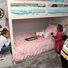 Bob's Discount Furniture partnered with the Boston Bruins and One Mission to donate and deliver new home furnishings to a local Fitchburg family. The youngest of the family Juliet Robichaud, 3, is currently battling Acute Myeloid Leukemia and Bob's wanted to commend her bravery by gifting Juliet her dream bedroom! In addition, the rest of the family got gifts for their rooms from the Bruins. Bruins Alum PJ Stock and mascot Blades were on hand to welcome Juliet home from school and surprise her with her new room on Tuesday, Jan. 7, 2019. Juliet shares a room with her sister Ellie, 7. Ellie, on left, and Juliet with Blades look over their new room. SENTINEL & ENTERPRISE/JOHN LOVE