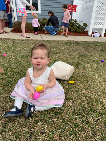 Brooke Wingate of Nashua gathers her Easter eggs.