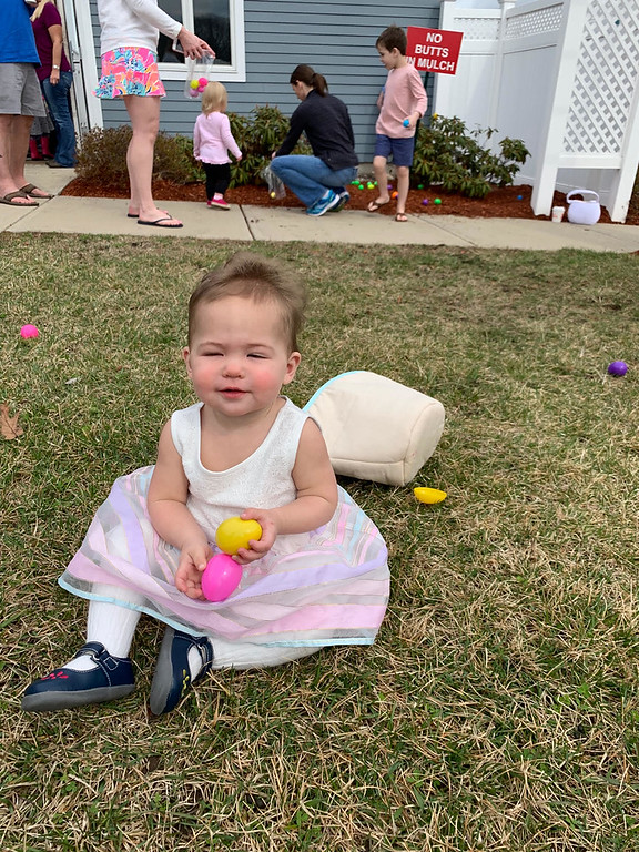 . Brooke Wingate of Nashua gathers her Easter eggs.