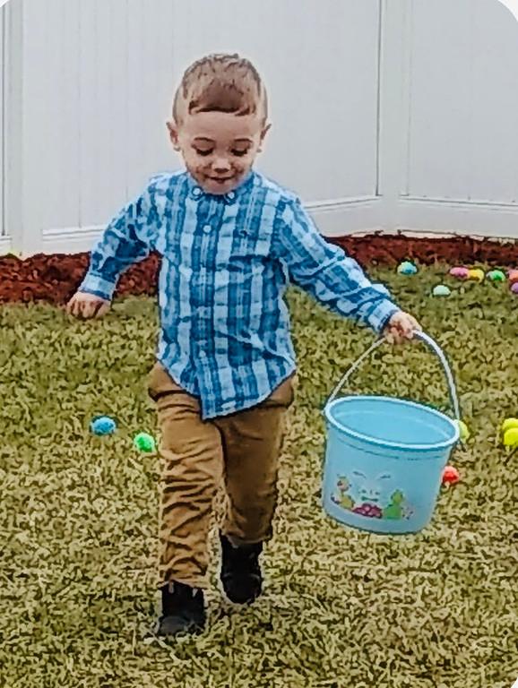 . Duke Peterson of Westford hunts for Easter eggs.