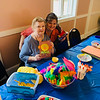 Sandra Porter and Melissa DeBeaucourt, both of Chelmsford, volunteering at the arts-and-crafts table.