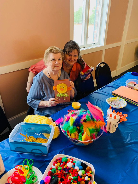 . Sandra Porter and Melissa DeBeaucourt, both of Chelmsford, volunteering at the arts-and-crafts table.