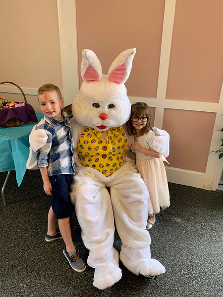 The Easter Bunny gets hugs from Sean Paul Coffey of Billerica and Ava Lowney of Dracut.