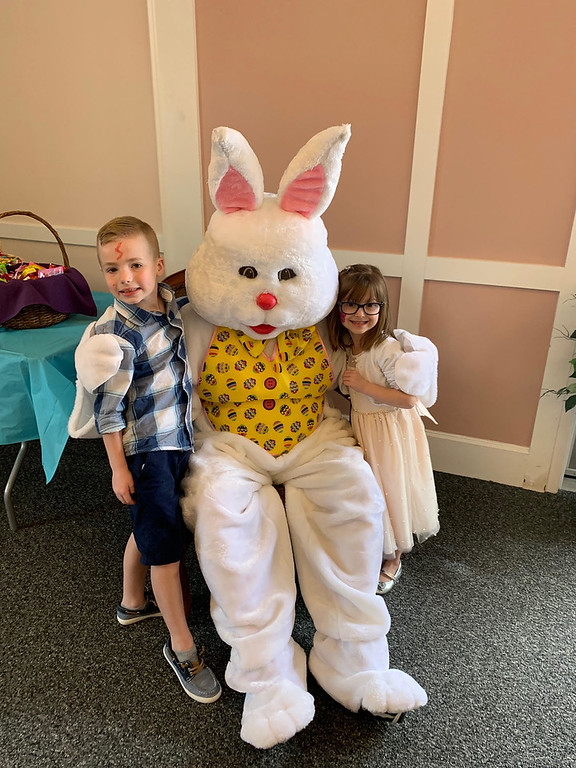 . The Easter Bunny gets hugs from Sean Paul Coffey of Billerica and Ava Lowney of Dracut.
