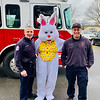 Chelmsford firefighters Tim Shanahan and Tim McNiff deliver the Easter Bunny safely to the Elks Club.