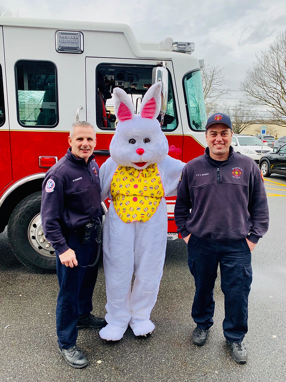 . Chelmsford firefighters Tim Shanahan and Tim McNiff deliver the Easter Bunny safely to the Elks Club.