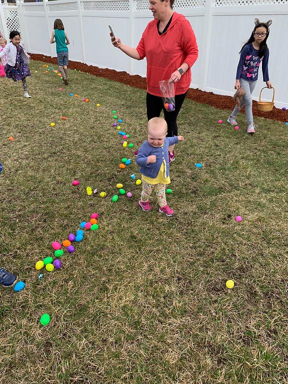 . Bella loves the Easter egg hunt.