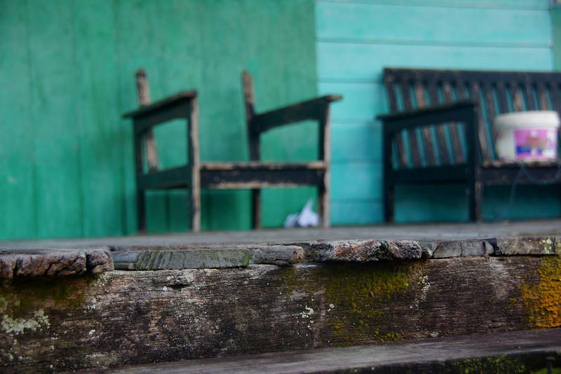 """An abandoned chair and bench at Kampong Ayers (Water Stilt Village) - Bandar Seri Begawan, Brunei.  This is a travel photo from Bandar Seri Begawan, Brunei. <a href=""""http://nomadicsamuel.com"""">http://nomadicsamuel.com</a>"""