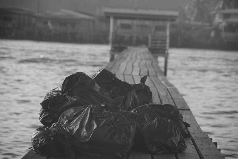 "Today's daily travel photo is of garbage bags along the walkway area of Kampung Ayer Water Stilt Village in Bandar Seri Begawan, Brunei:<br /> <a href=""http://nomadicsamuel.com/photo-blog/garbage-bags-on-kampung-ayer-water-stilt-brunei"">http://nomadicsamuel.com/photo-blog/garbage-bags-on-kampung-ayer-water-stilt-brunei</a>"