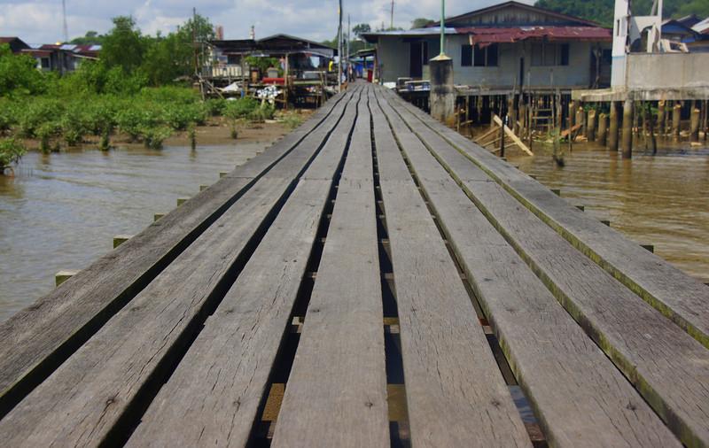 "A board walk (ramp) connecting one section of the water stilt village to another - Kampong Ayer, Brunei.  Travel photo from Bandar Seri Begawan, Brunei. <a href=""http://nomadicsamuel.com"">http://nomadicsamuel.com</a>"