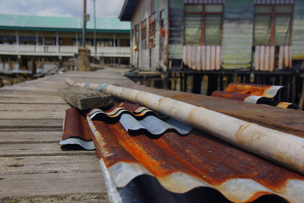Discarded rustic waste materials left outside the Kampung Ayer (water stilt village) - Bandar Seri Begawan, Brunie.  This is a travel photo from Bandar Seri Begawan, Brunei.