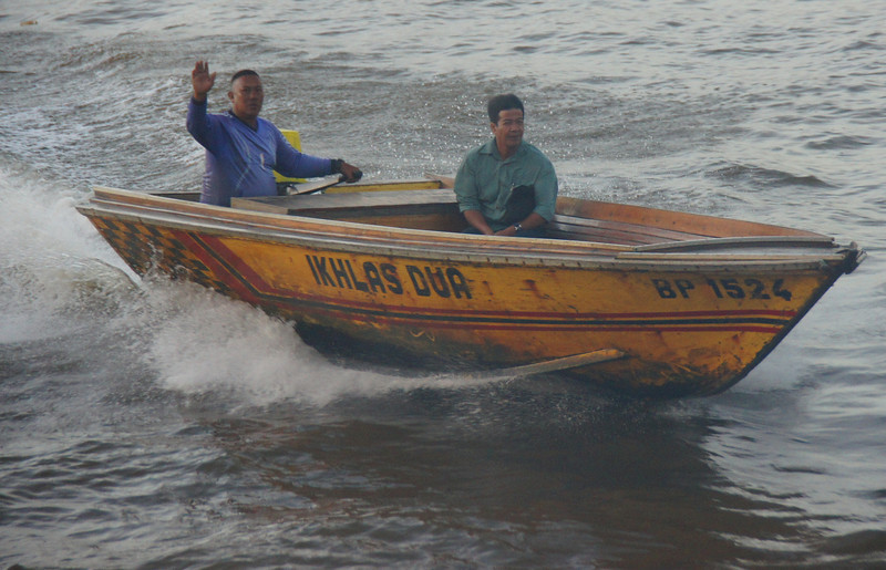 Today's daily travel photo is of a couple of men speeding down the Brunei River on a speedboat in Bandar Seri Begawan, Brunei.  The speedboats are clustered around Kampung Ayer (the water stilt village) and can be hired - although it is quite expensive.