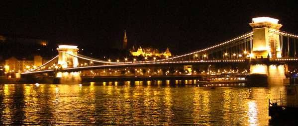 I walked across the bridge on our first night in Budapest.  Castle lit up on a Buda hill in background