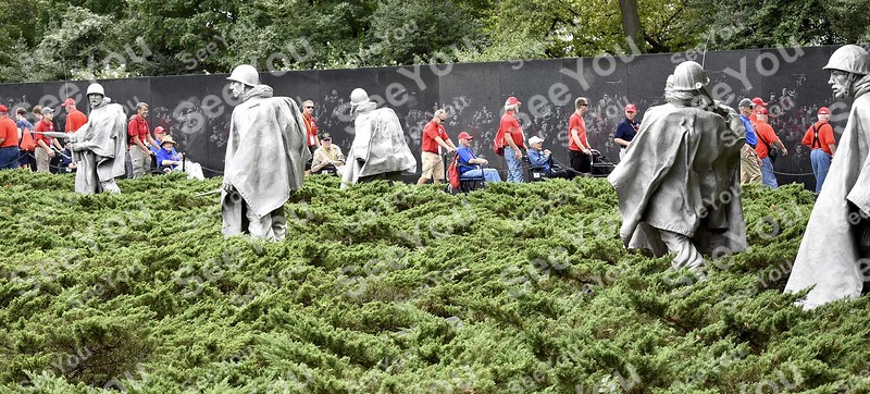 -Messenger photo by Joe Sutter<br /> <br /> Veterans from Honor Flights from the Fort Dodge region, Wisconsin, and Florida tour the Korean War Memorial Saturday.