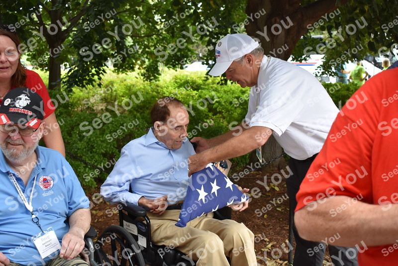 -Messenger photo by Joe Sutter<br /> <br /> Terry Moehnke, of Fort Dodge, shows former U.S. Sen. Bob Dole the flag and photo of Nick Conrad, a veteran who passed away just a few weeks ago.