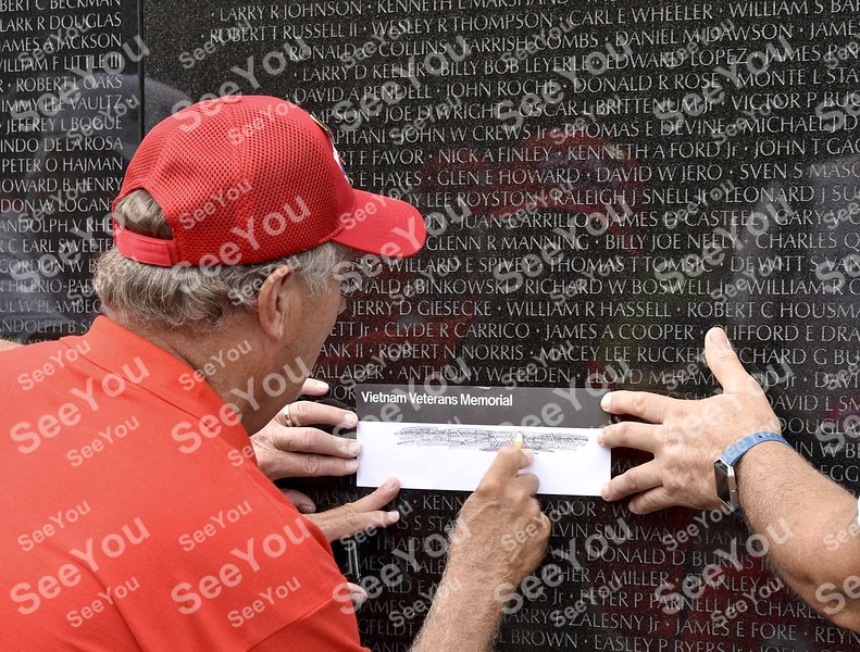 -Messenger photo by Joe Sutter<br /> <br /> Army Veteran Dean Christiansen, who served in Vietnam, takes a rubbing of Steven Backhaus's name from the Vietnam Memorial wall. He was also there to find Albert Benson's name. They were a couple college buddies of his, Christiansen said; Steven was only over there a few days.