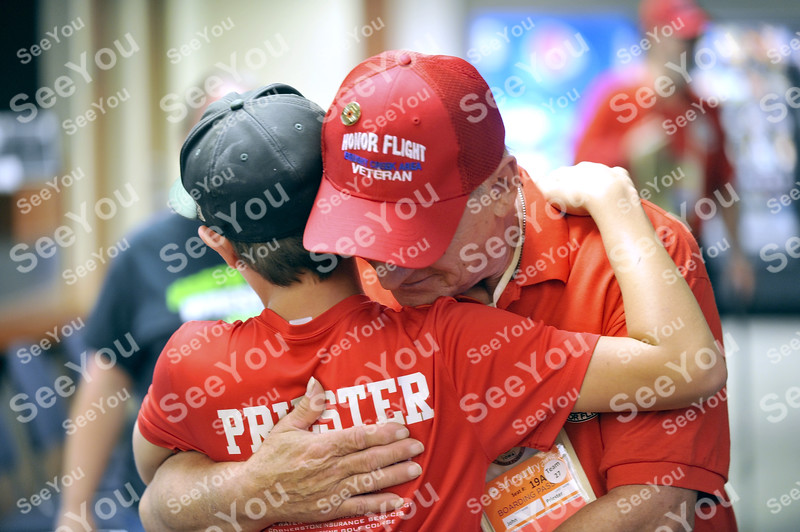 -Messenger photo by Hans Madsen<br /> <br /> John Priester, of Swea City, gets a hug from his grandson, Talan Priester, as he prepares to board the Brushy Creek Area Honor Flight for Washington D.C. Saturday morning at the Fort Dodge Regional Airport.
