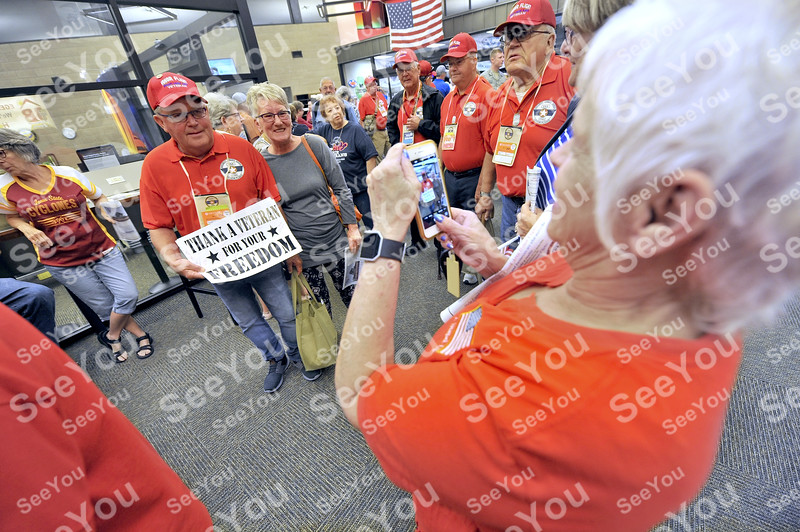 -Messenger photo by Hans Madsen<br /> <br /> Navy veteran Carroll Olson, of Okoboji, poses for a picture with his partner Marilyn Point as he prepares to depart from the Fort Dodge Regional Airport Saturday morning for the Brushy Creek Area Honor Flight to Washington D.C.