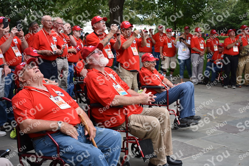 -Messenger photo by Joe Sutter<br /> <br /> Veterans look up as the flag is lowered for the evening at Arlington National Cemetery.