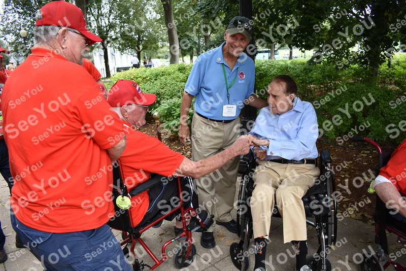 -Messenger photo by Joe Sutter<br /> <br /> Former U.S. Sen. Bob Dole meets World War II Army veteran Richard Hussey, of Storm Lake, at the World War II memorial.