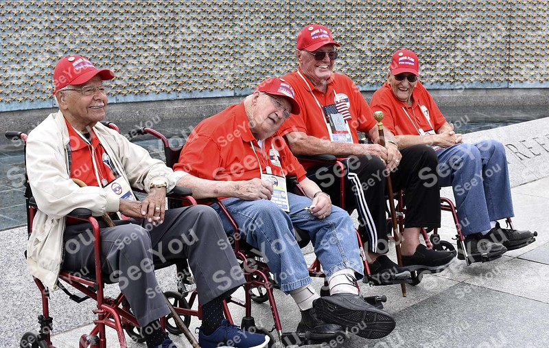 -Messenger photo by Joe Sutter<br /> <br /> The four World War II Veterans from the Sept. 2018 Brushy Creek Area Honor Flight pose in front of the wall of stars at the WWII memorial. From left <br /> Orsel Morrow, Army; Harvey Bjornson, Navy; Richard Hussey, Army; and Robert Broadie, Navy. <br /> Each star stands in for 100 military deaths in the war.