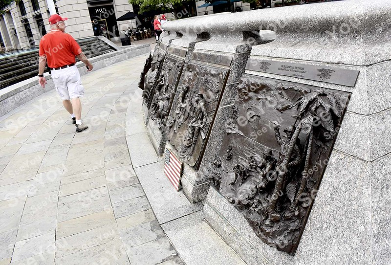 -Messenger photo by Joe Sutter<br /> <br /> Veterans tour the Navy Memorial in Washington, DC which includes 3-dimensional metal sculptures of Navy moments. A flag plaque in memory of Sen. John McCain rests under one image, from the Holms-Wayne County Ohio Veterans.