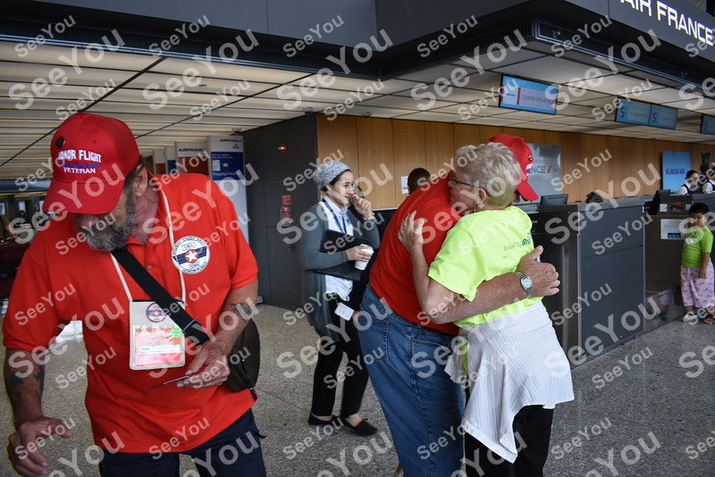 -Messenger photo by Joe Sutter<br /> Gail Greenberg of the Honor Flight network gives a hug to Roger Leerar as hundreds of volunteers welcome the Iowa veterans to Dulles airport Saturday morning.