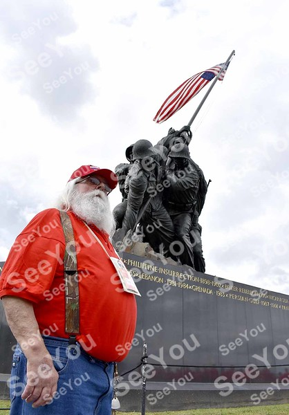 -Messenger photo by Joe Sutter<br /> <br /> Navy Veteran James Ross, Gilmore City, poses for a picture in front of the memorial to the U.S. Marines commemorating the taking of Iwo Jima during World War II.