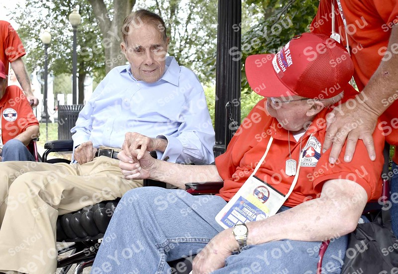 -Messenger photo by Joe Sutter<br /> <br /> Former U.S. Sen. Bob Dole meets U.S. Navy World War II Veteran Harvey Bjornson at the WWII memorial in Washington Saturday. Veterans from the flight met with Dole at the memorial, which has a plaque in place thanking Dole for his support of World War II veterans.